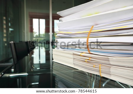 stack of documents or files in office desk - stock photo