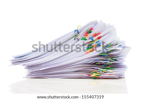 Stack of documents with colorful clips isolated on white background - stock photo