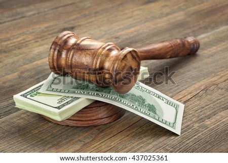Stack Of Dollar Banknotes With Judges Or Auctioneers Gavel Or Hammer, Trial Or Tribunal Concept, Auction Concept, Close Up - stock photo