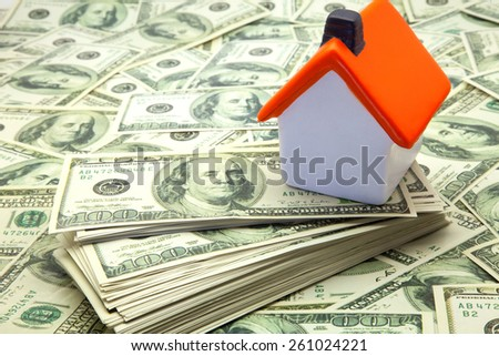 stack of dollar bills and House