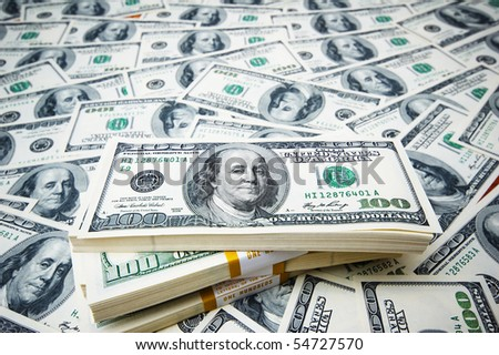 Stack of dollars on money background - stock photo