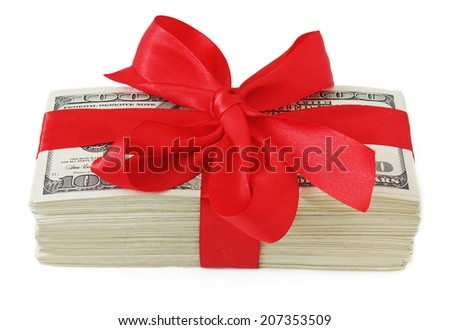 Stack of dollars with red bow isolated on white background. Money gift concept - stock photo