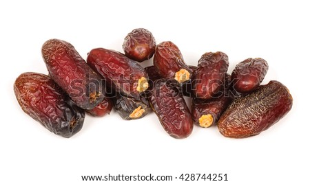 Stack of dried dates fruits isolated on white background (It is expensive compared to other types of dates due to its scarcity, its majestic look, and it's nice smell.)