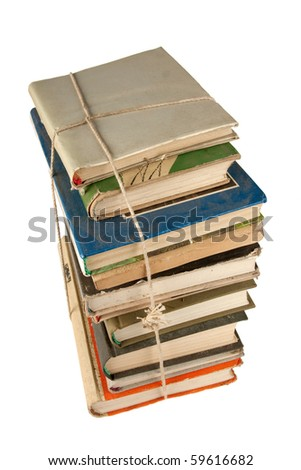 Stack of dusty  books isolated on white background - stock photo