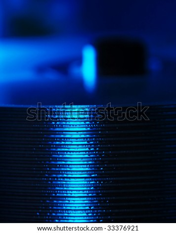 Stack of DVDs in blue light - stock photo
