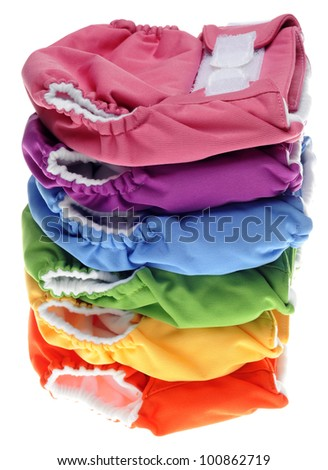 Stack of Eco Friendly Cloth Diapers on White. - stock photo