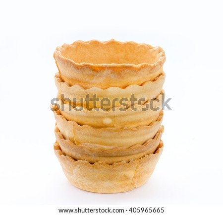 Stack of empty tartlets isolated on white background