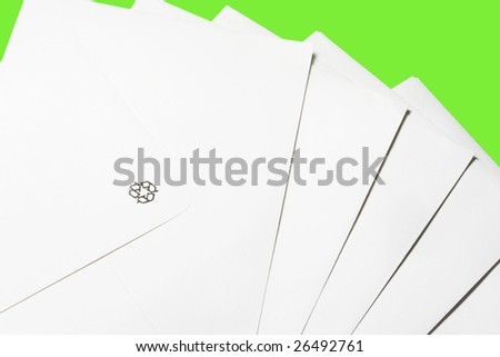 Stack of envelopes/letters on green background - stock photo
