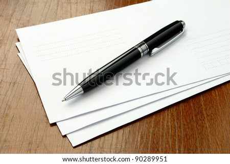stack of envelopes on a brown table - stock photo