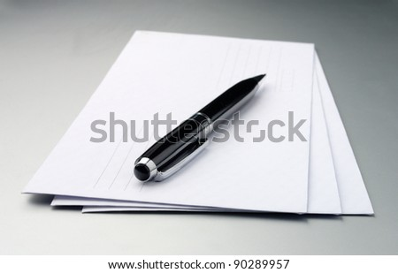 stack of envelopes on a gray table - stock photo