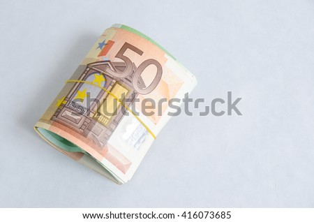 Stack of Euro banknotes isolated white background
