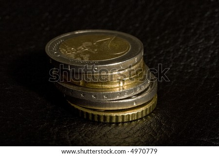 "stack of Euro coins, the top coin is from Slovenia, only the letters ""L O V E"" from SLOVENIJA are visible, pun intended"