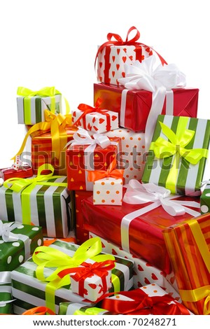 stack of festive gift boxes decorated with satin bow isolated on white background - stock photo
