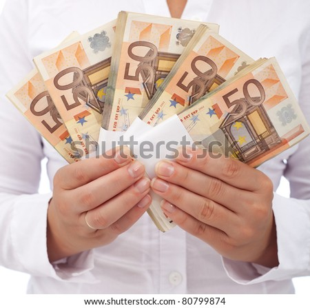 Stack of fifty euro banknotes in woman hands - closeup - stock photo