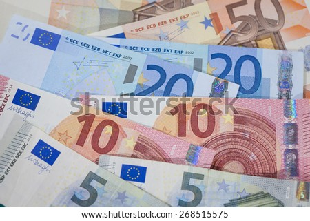 Stack of Fifty, Twenty, Ten and Five Euro Notes - stock photo
