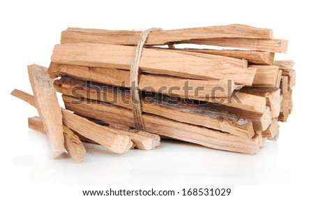 Stack of firewood isolated on white - stock photo