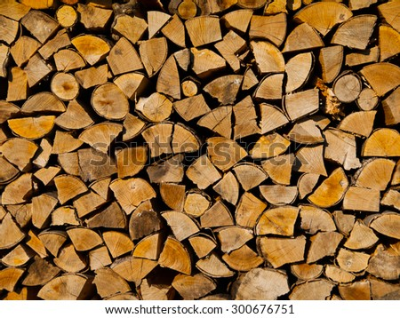 Stack of firewood, wood logs texture background - stock photo