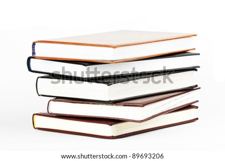 Stack of five books on the white background