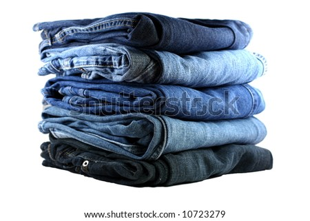 stack of five various shades of blue jeans on a white background - stock photo