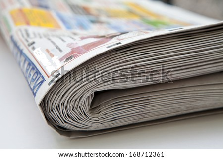 Stack of folded newspapers close-up