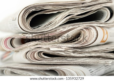 stack of folded newspapers closeup - stock photo