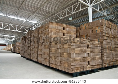 Stack of folded paper box in warehouse - stock photo