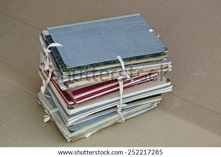 stack of folders full of old documents - stock photo