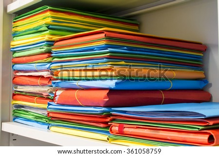 Stack of folders with archival documents in the office