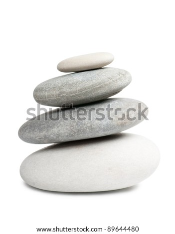 Stack of four round stones isolated over white background - stock photo