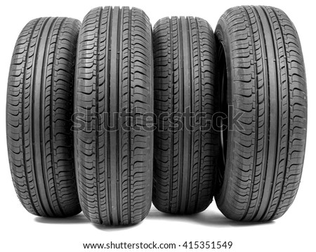 Stack of four wheel new black tyres for summer car driving isolated on white background - stock photo