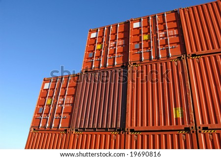 Stack of freight containers in the harbor - stock photo