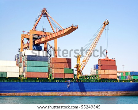 Stack of freight containers on ship deck - stock photo