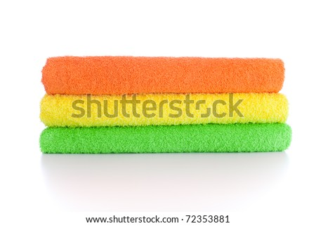 stack of fresh colorful towels isolated - stock photo