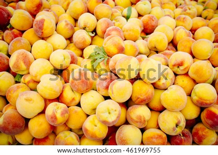 stack of fresh ripe peaches fair