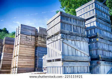 Stack of fruit boxes or crates sit outside a warehouse  - stock photo