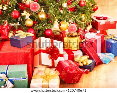 Stack of  gift box by Christmas tree.  Isolated. - stock photo