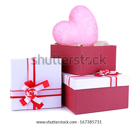 Stack of gift boxes and decorative heart, isolated on white - stock photo