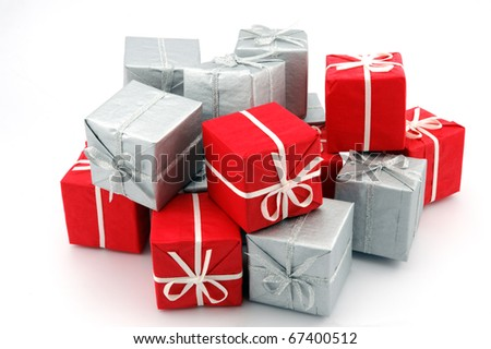 Stack of gift red and silver boxes over white background - stock photo