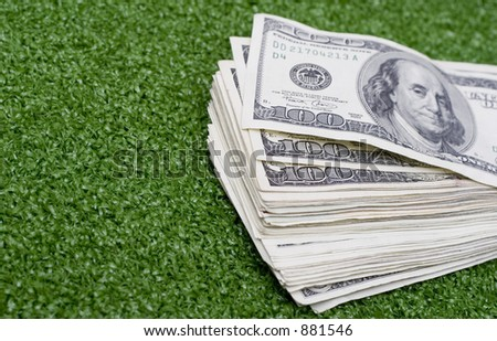 stack of green money on green background - stock photo