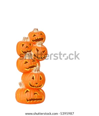 Stack of Halloween Pumpkins - A carved jack o lantern pumpkin stack isolated on white with space for copy. - stock photo