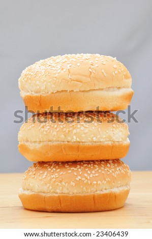 Stack of Hamburger Buns on Wood Table