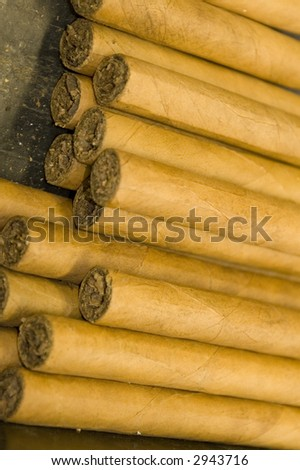 stack of hand made custom cigars luxury expensive - stock photo
