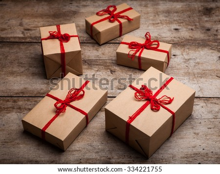 Stack of handcraft gift boxes. Christmas decoration - stock photo