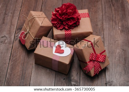 Stack of handcraft gift boxes on a wooden table - stock photo