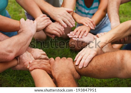 Stack of hands - real people agreement