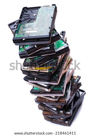 Stack of hard disk drives. Closeup with with shallow DOF. Isolated on white background. - stock photo