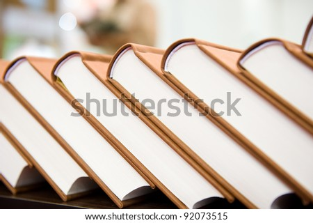 stack of hardcover books in a line. - stock photo