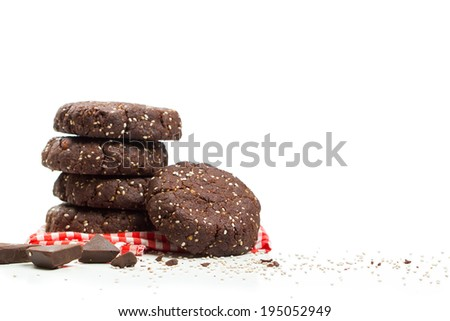 Stack of healthy dark chocolate chia seed cookies with ingredients - stock photo