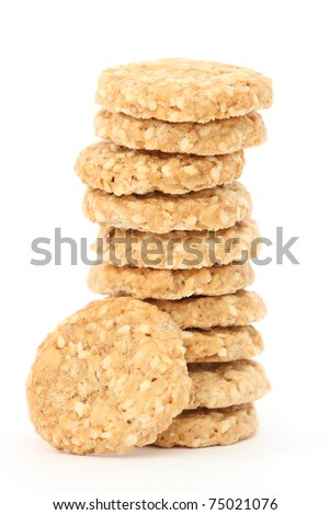 Stack of home made golden oatmeal and sesame cookies - stock photo
