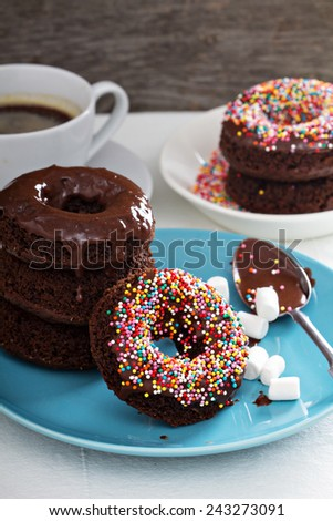 Stack of homemade baked chocolate donuts with glaze - stock photo